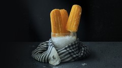 Learn everything about the dark and moody style while photographing popsicles with me